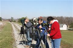 Avid Birders Andy Sewell, Bill Heck, and Lori Patterson scan intently for waterfowl