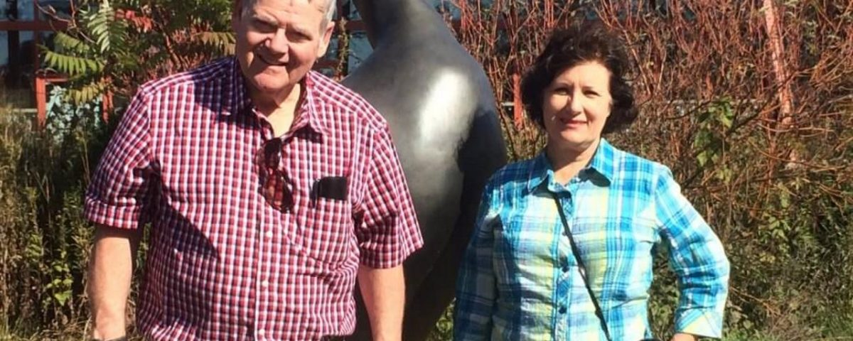 Gary and Kari with the Passenger Pigeon Lost Bird Sculpture